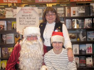 Santa, with James Robert White and BEF Book Fair organizer Linda White